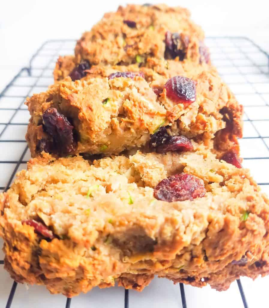Slices of gluten free zucchini cranberry bread on cookie sheet